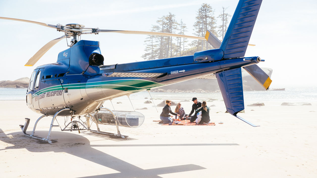 Private beach picnic with a helicopter from Nimmo Bay Resort