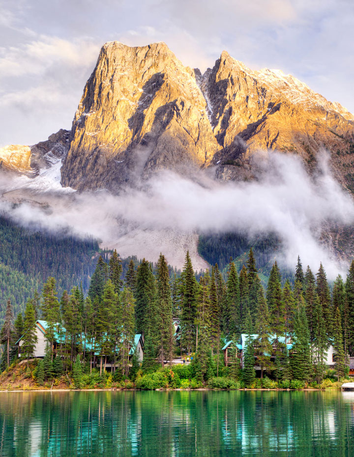 The Emerald Lake Lodge tucked into the trees with mountain behind