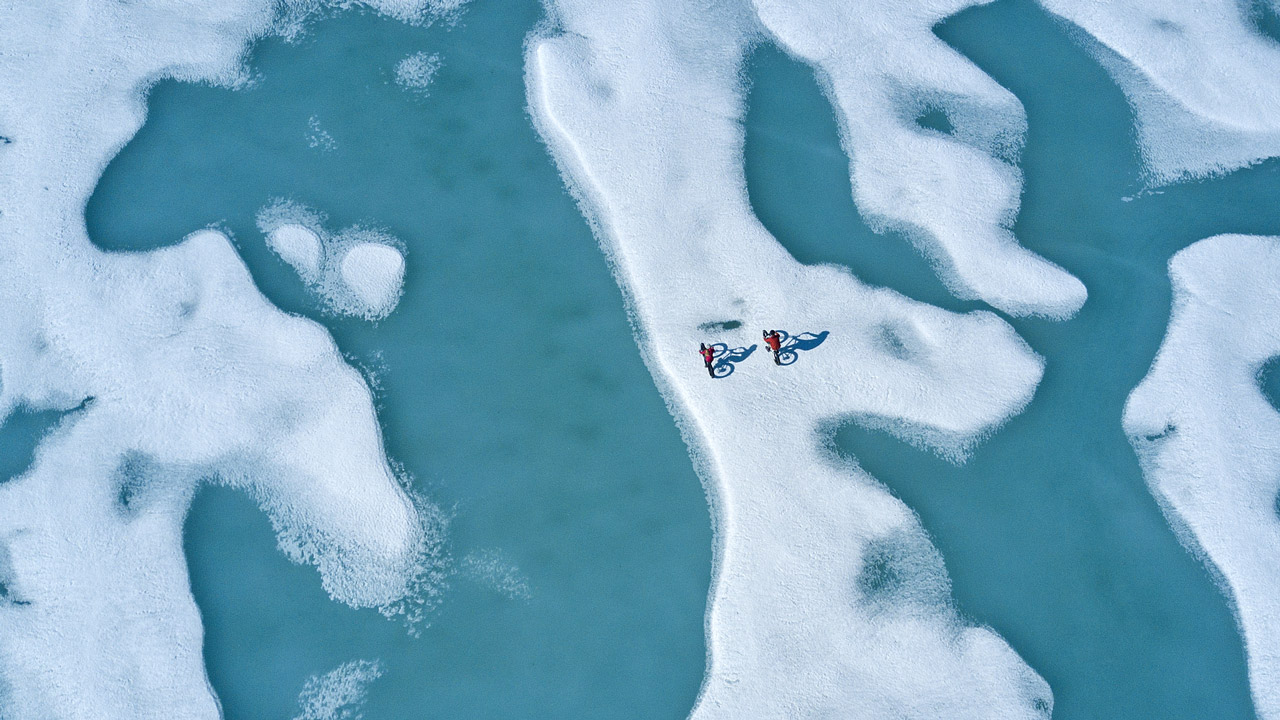 Two people Fat Biking on the ice of the Northwest Passage