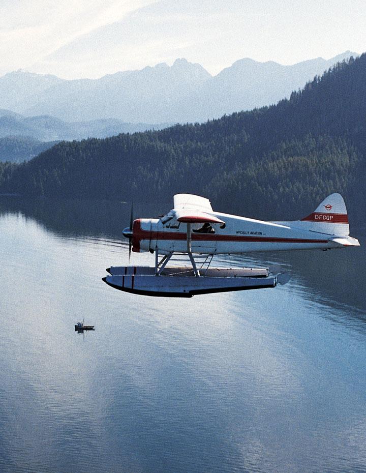 Floatplane flying over mountains near Tofino