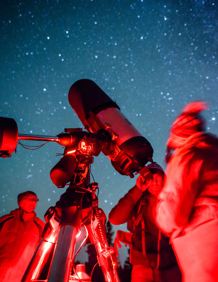 People looking through a telescope at the Jasper Dark Sky Festival