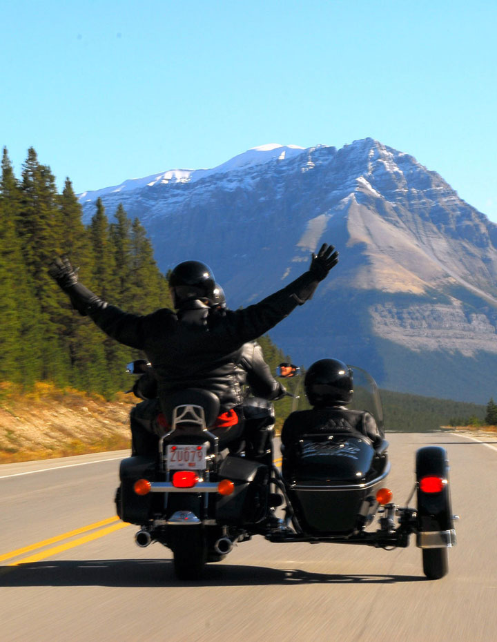 Couple on a Sidecar Motorcycle tour through Jasper National Park