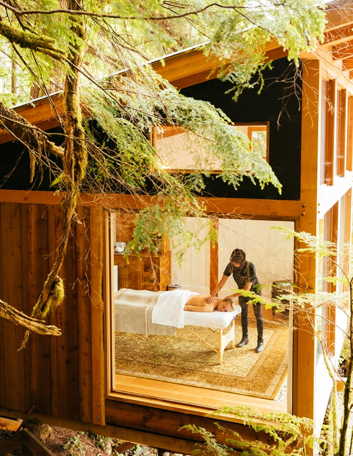 Nimmo Bay Resort's Wellness Cedar Room where woman is receiving a massage