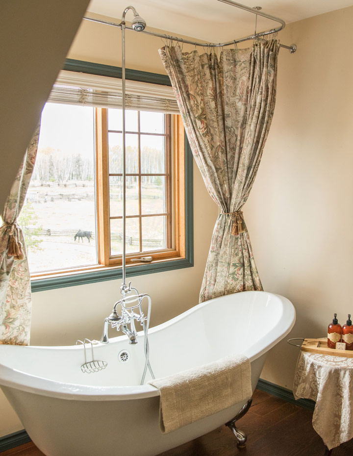 Clawfoot bathtub next to a window in the Ranch House Suite at the Siwash Lake Wilderness Resort