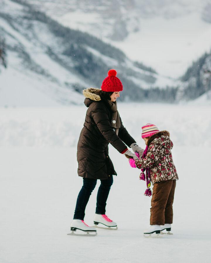 Mother and daughter skating at Lake Louise, Alberta