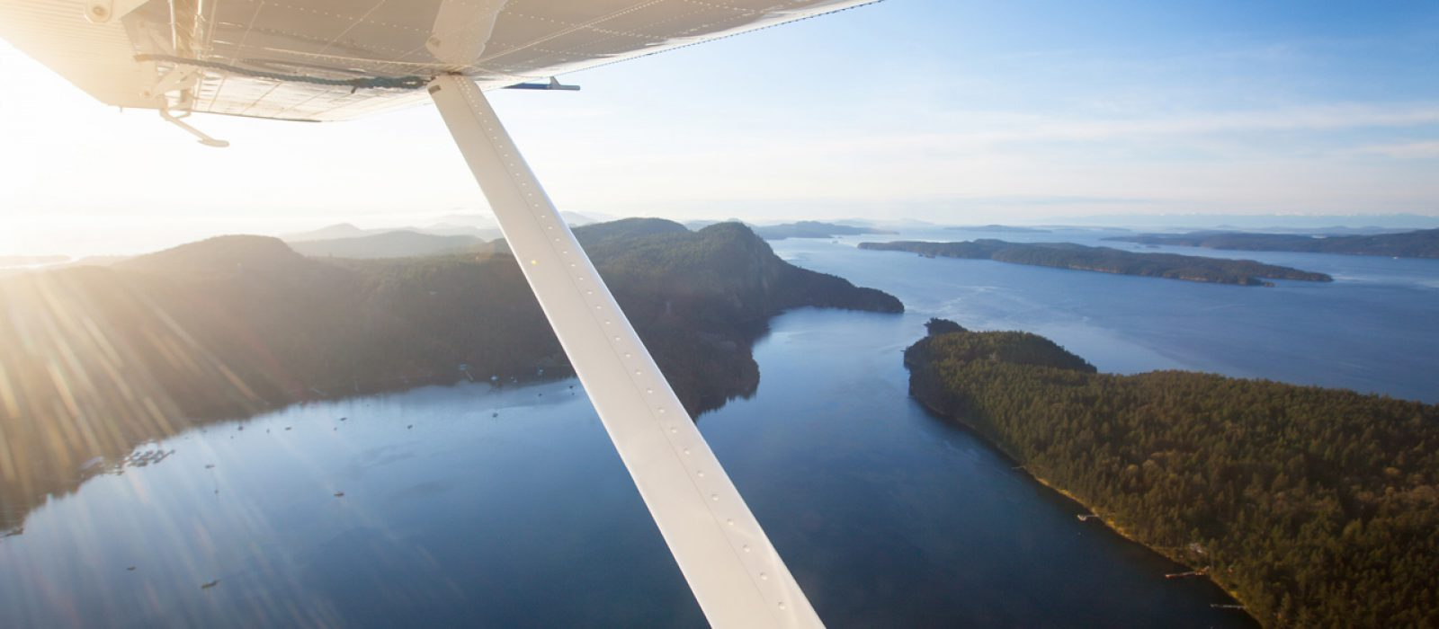 View from the wing of a seaplane flying over British Columbia's Gulf Islands