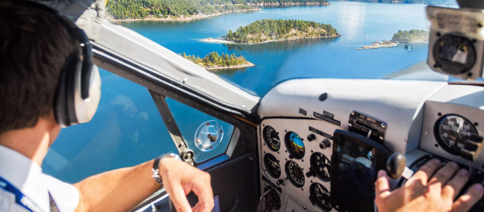 View from pilots sea in a Harbour Air Seaplane flying over the coastal islands of British Columbia