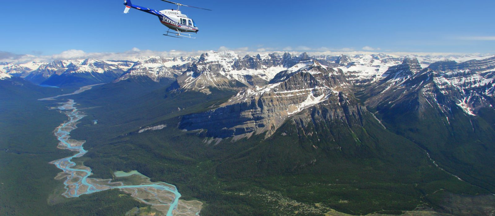 Helicopter flying over the Icefields in the Canadian Rockies in Alberta
