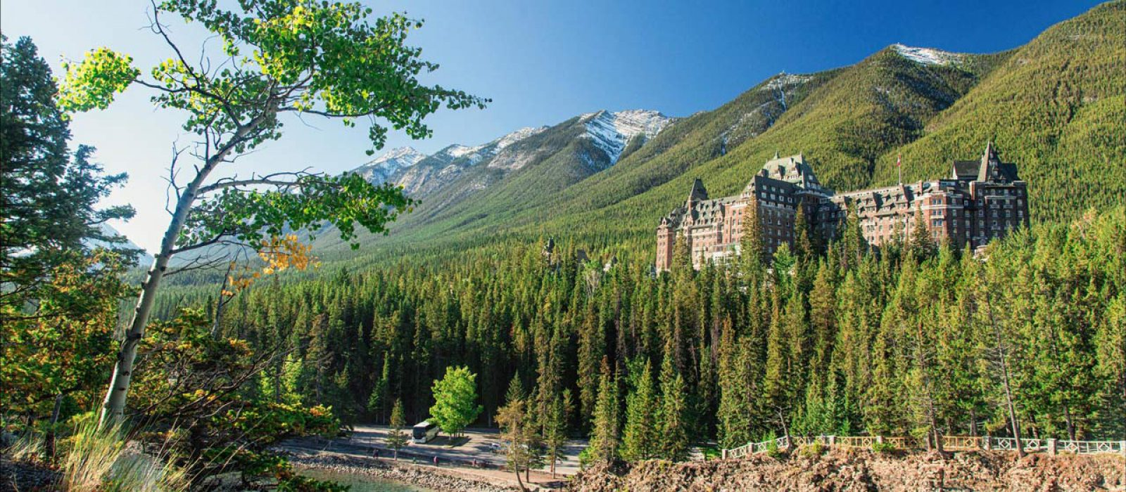 The Fairmont Banff Springs hotel in the forest near the Bow River