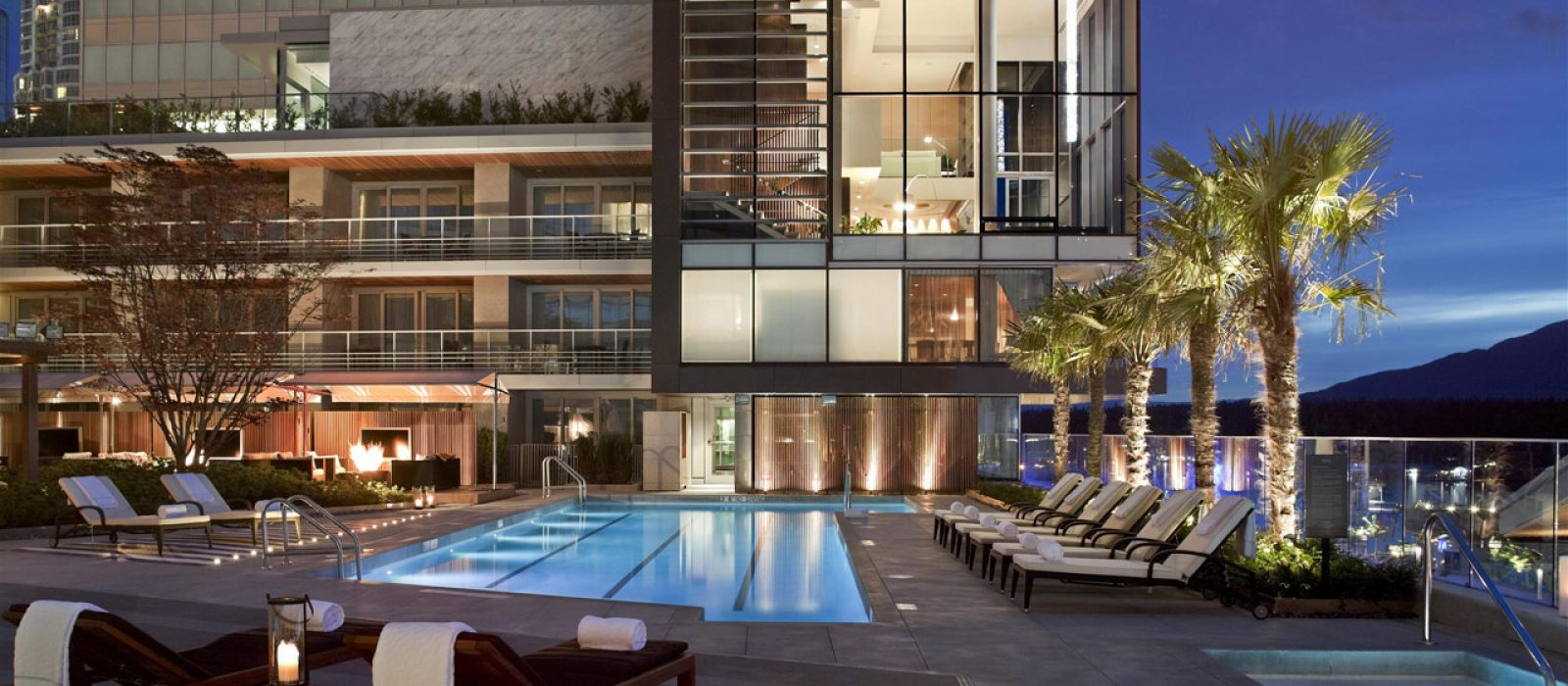 Luxurious pool deck at the Fairmont Pacific Rim at night