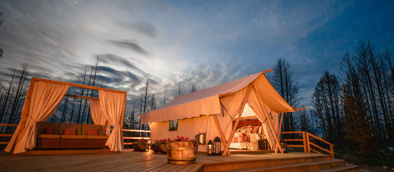 Outdoor glamping tent at night at the Siwash Lake Wilderness Resort
