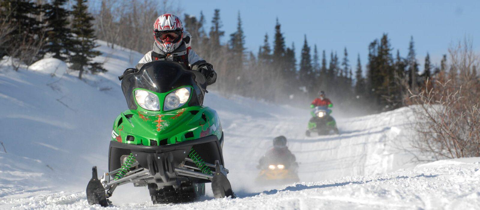 Snowmobiling in the Yukon, Canada.